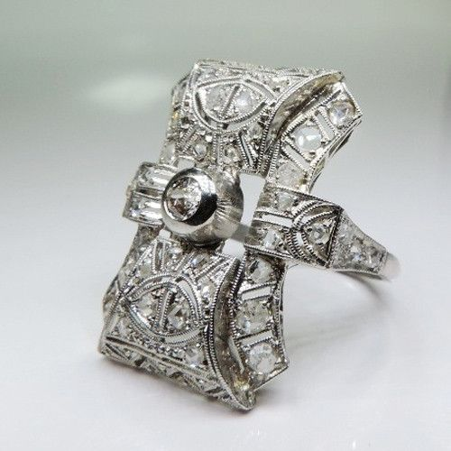 Period: Art deco (1920-1935) Composition: Platinum Stones: - 1 Old mine cut diamond of H-I1 quality that weighs 0.25ctw. - 46 Rose cut diamonds of H-SI1 quality that weigh 0.80ctw. Ring size: Ring fac