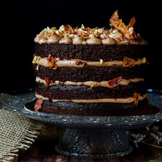 This chocolate bacon cake is a showstopper! Chocolate stout sponge cake, Swiss meringue buttercream and crispy bacon - delightful!