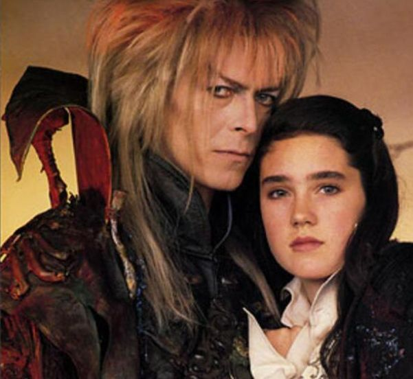 @LabyrinthWiki: Jareth (David Bowie) looking v. possessive of Sarah (Jennifer Connelly) in this rare #Labyrinth publicity shot <---- W.H.O.A... this shot is intense... you can feel the attractiveness oozing...