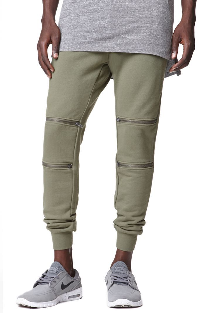PacSun presents the Bullhead Dillon Skinny Zippers Jogger Sweatpants for men. These olive men's jogger pants come with some style thanks to the zippered knees and elastic cuffs.	Olive jogger pants	Bullhead logo sewn above back pocket	Two zippers on each knee	Slant front pockets	Button waist, zip fly	Skinny fit	Machine washable	100% cotton	Imported