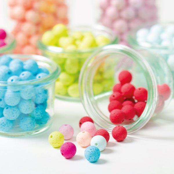Polaris gala sweet Perlen - in das Perlenrohmaterial werden Zuckerkristalle eingearbeitet. Bei der Produktion schmilzt der Zucker und man erhält eine Perle die aussieht wie eine Lavaperle.