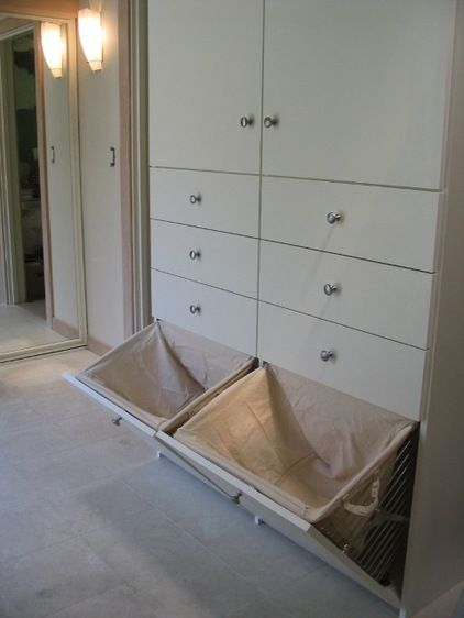 If you have space in a drawer or closet, consider retrofitting it with pull-down hampers. Removable liners make it a snap to carry clothes t...