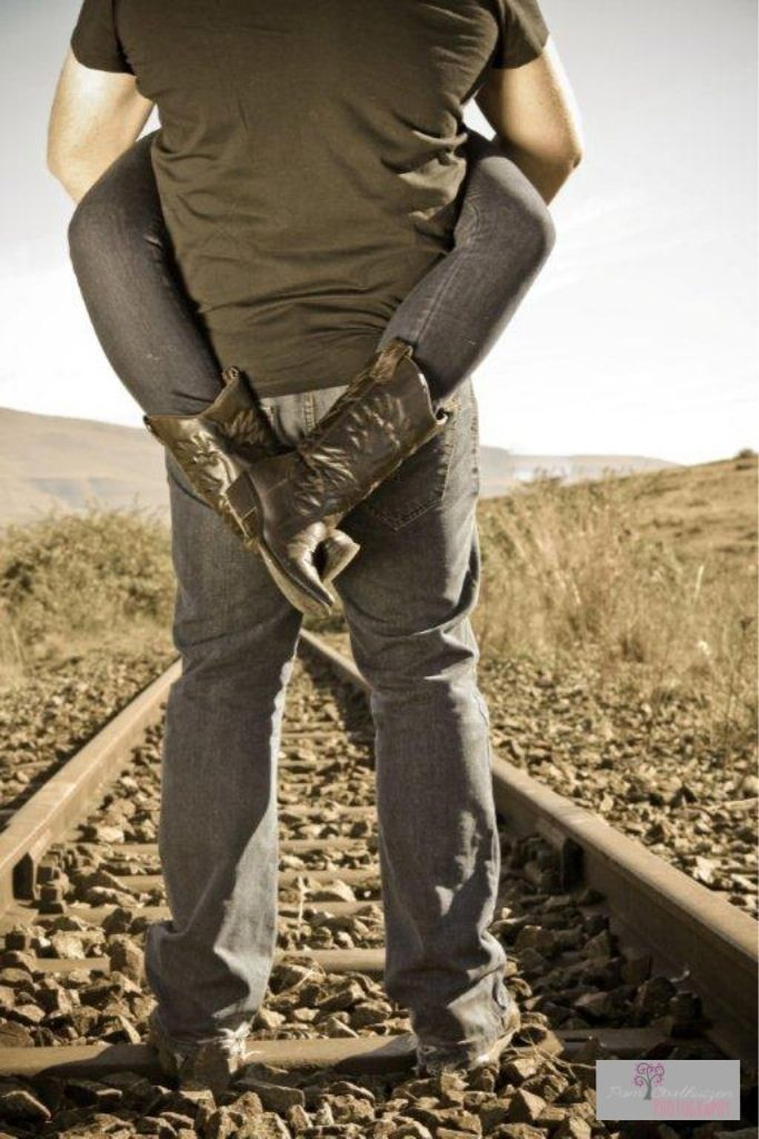 Cowgirl boots on a railway line