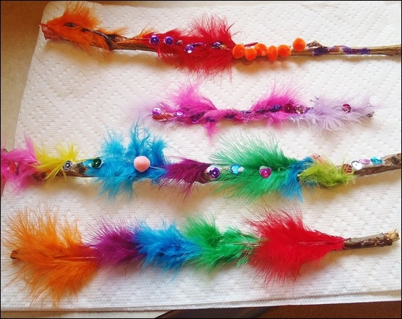 "Lovely magic wands , made by decorating sticks with feathers, pom-poms & sequins ("",)"