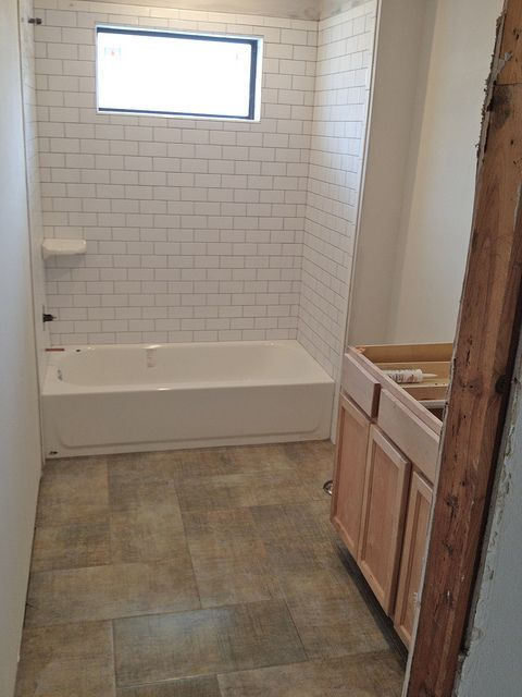 12x24 Porcelain Tile In Herringbone Layout Bathroom