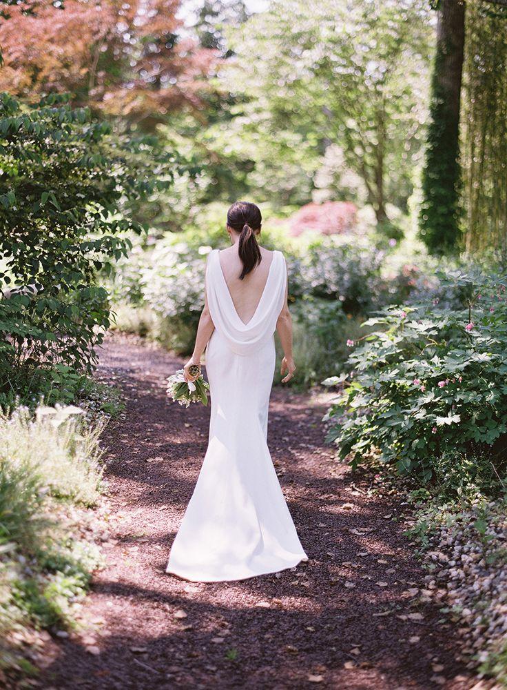 elegant back draping bridal gown   Photography: Braedon Weddings