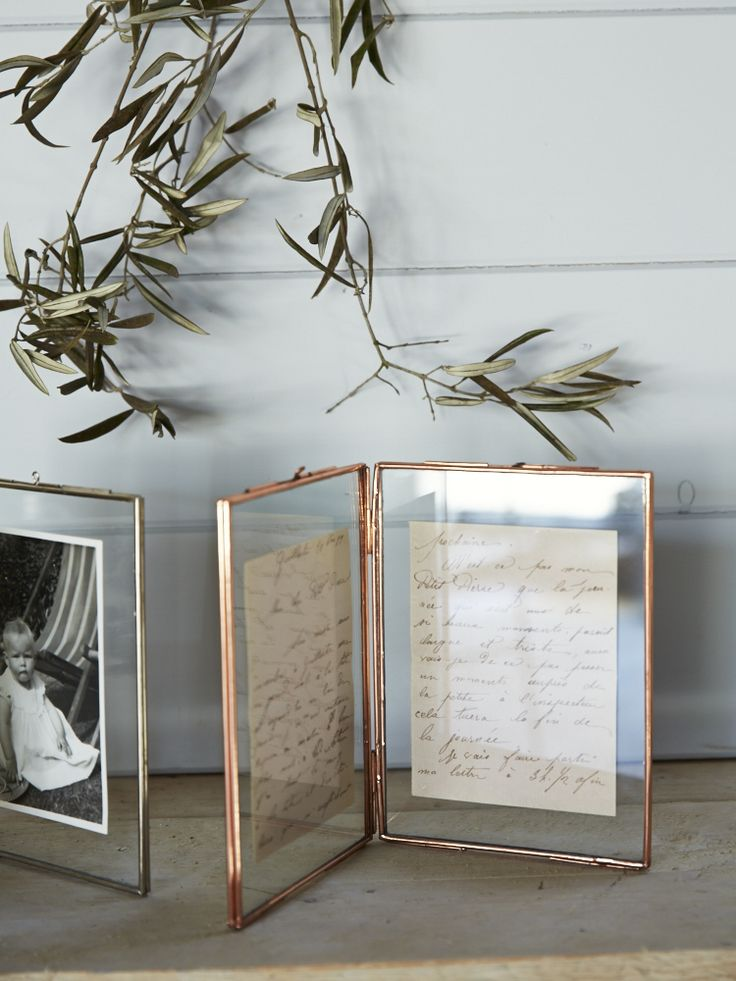 Hinged Glass Photo Frame with delicate Copper Frame. I like this because you can display both sides of a photo.   Great for photos that have names written on the back, or postcards or treasured letters.
