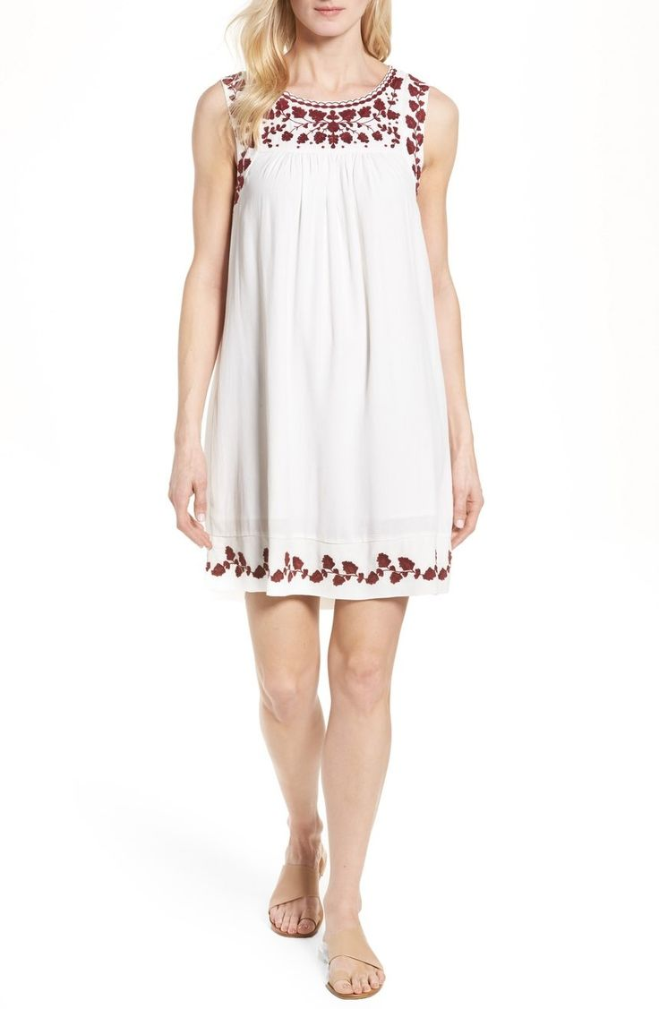 Can't get over the embroidered detailing on this flowy and fun white dress.