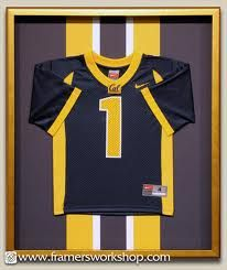 shadow box framed jersey i like the use of varsity fabric behind the small jersey
