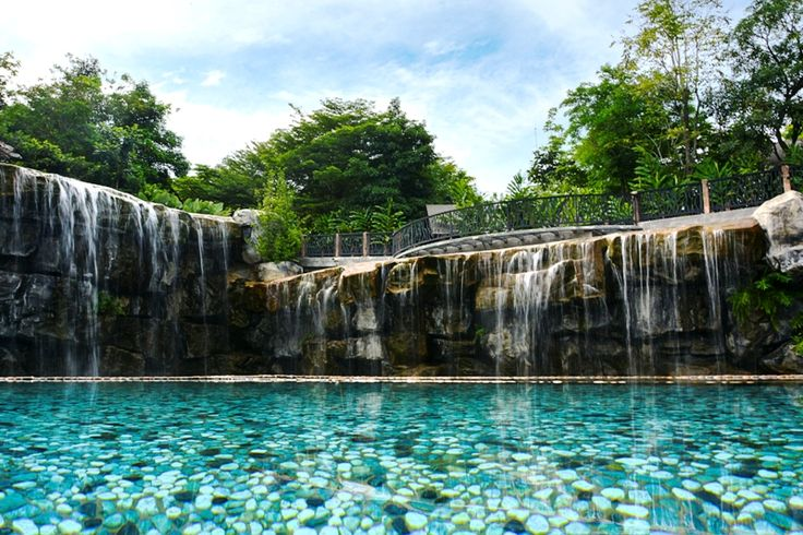 The pool overlooking the man-made waterfall is the highlight of the resort. The flora and fauna surrounding the resort as well as fresh air are bound to put one in high spirits and a relaxing swim would be a great stress reliever. #swimmingpool #manmadewaterfall