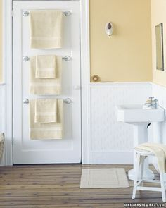 Install multiple towel rods on the back of your door. This idea is growing on me more and more. I like that your towels are not the first people see when they come into your bathroom.