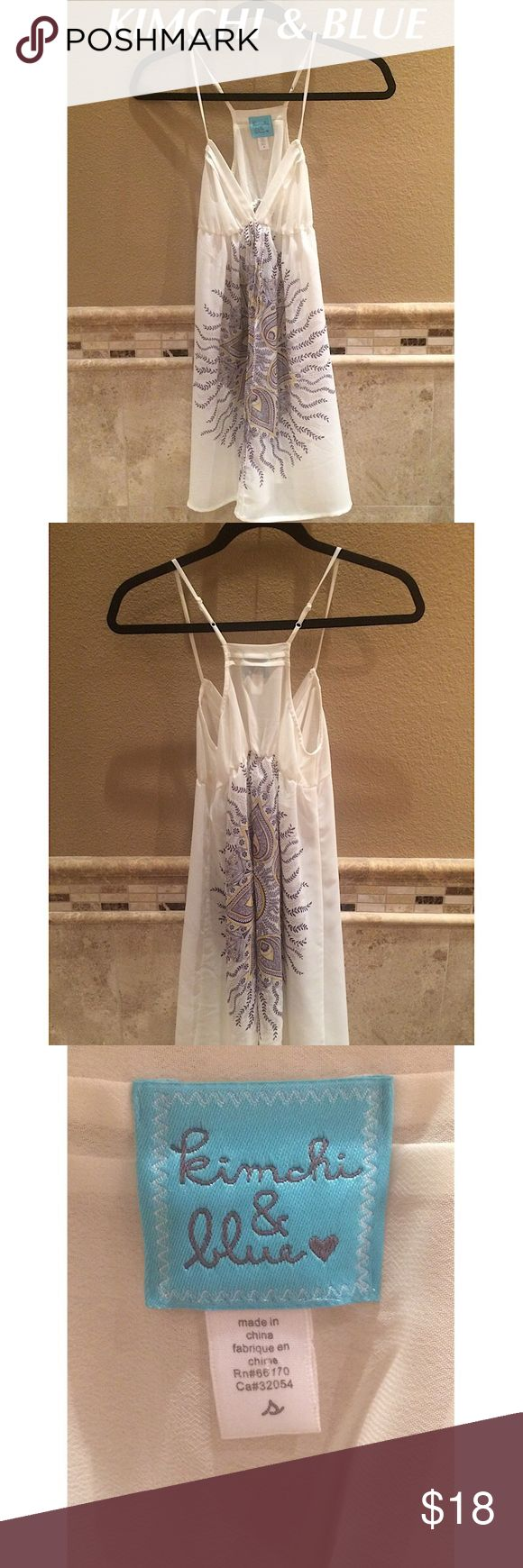 Urban Outfitters KIMCHI & BLUE Sheer Dress Perfect for the spring & summer!  A sheer KIMCHI & BLUE by Urban Outfitters babydoll dress in cream with a purple and yellow design on both front and back. Other ideas for wear: as a long top to wear over tight capris or even lingerie.  Pre-owned, probably worn a couple of times & in excellent condition.  Recommend a slip of some sort.  Super cute!  Ask all questions prior to purchase. Kimchi Blue Dresses