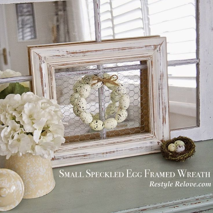 DIY: How to Make this Framed Speckled Easter Wreath - using styrofoam eggs threaded through wire and hung on an unused frame, backed with chicken wire - via Restyle Relove