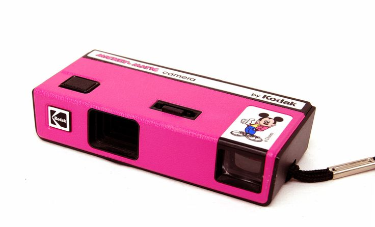 ripcityretro.etsy.com  Adorable little Mickey Mouse camera in bright pink by Kodak. Great little piece of retro decor! Has an attached wrist rope. The shutter works, but it hasnt been tested with film. **Sold As-Is. Brand: Mickey-Matic by Kodak  Measures about 4 1/2 x 2 1/4x 1  Condition: Nice! Looks barely used. Thanks so much for shopping.