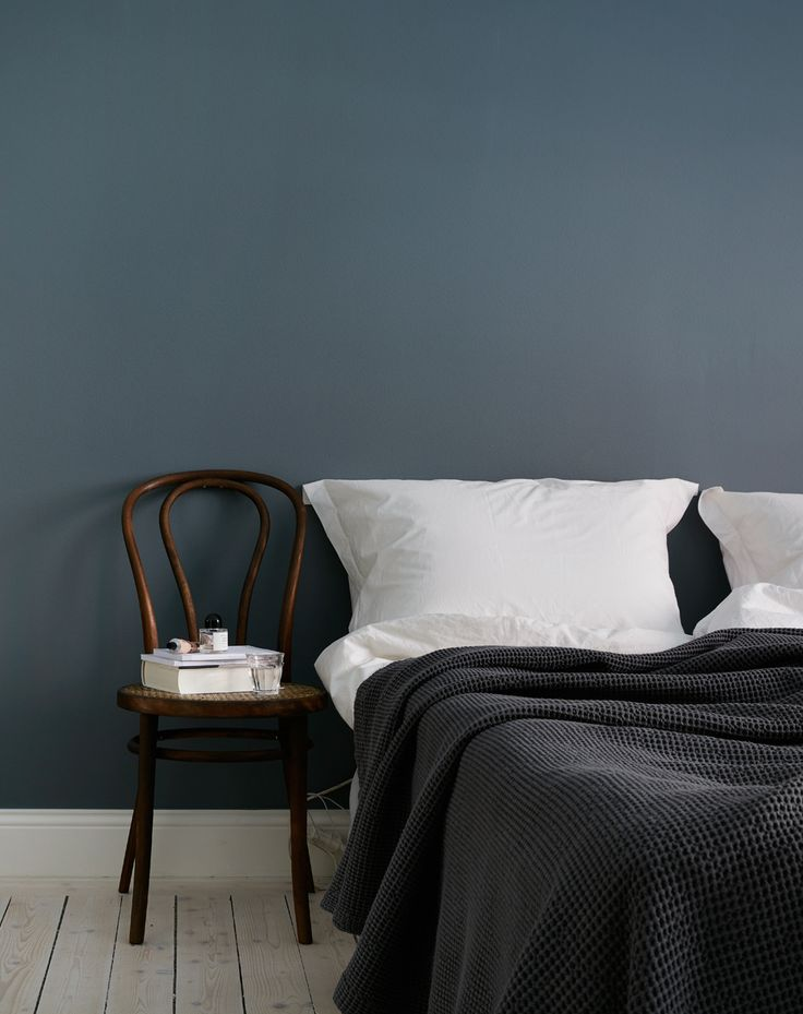 Cozy white home with a blue bedroom wall - via cocolapinedesign.com