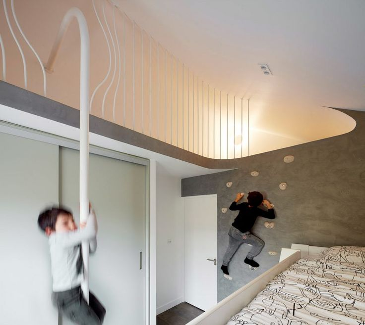 This project includes a fun bedroom for the children. A climbing wall provides access to a hideaway beneath the eaves of the original pitched-roof extension, from which the fastest way down is via a fireman's pole.