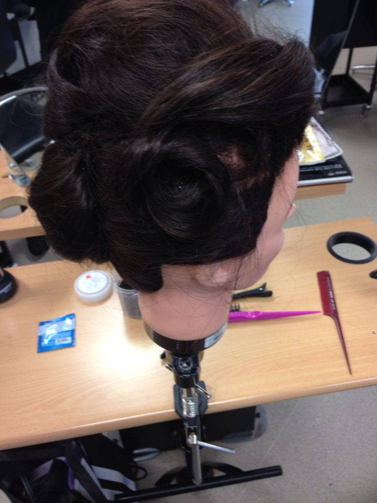 Side view of chignon pin curls