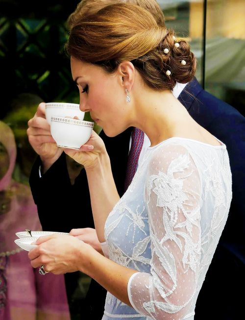 Kate sipping tea.