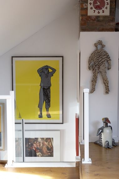 The yellow picture in the stairwell is by Irish artist Yvonne McGuinness, who is married to actor Cillian Murphy. The clock was bought in To...