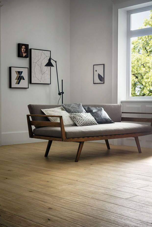 This is just perfect : Starting with the photo itself. The sofa's design, the wood color and how it contrasts with the floor parquet, the pillows and their geometric patterns, the space and the frames on the wall.