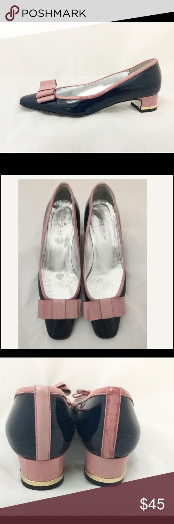 Dolce and Gabbana navy patent shoes with pink bows Dolce and Gabbana mod navy patent low heel pumps with pink eel skin bows and trims. Euro size 38 1/2. Us size similar to 8. Worn and there are scuffs on the sole. Little discoloration on back strip. Overall normal wear. Dolce & Gabbana Shoes Heels