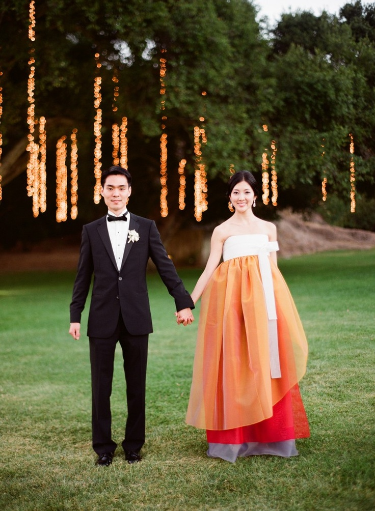 This bride took the traditional colors of the Kimono and incorporated a new wedding gown. Very chic...