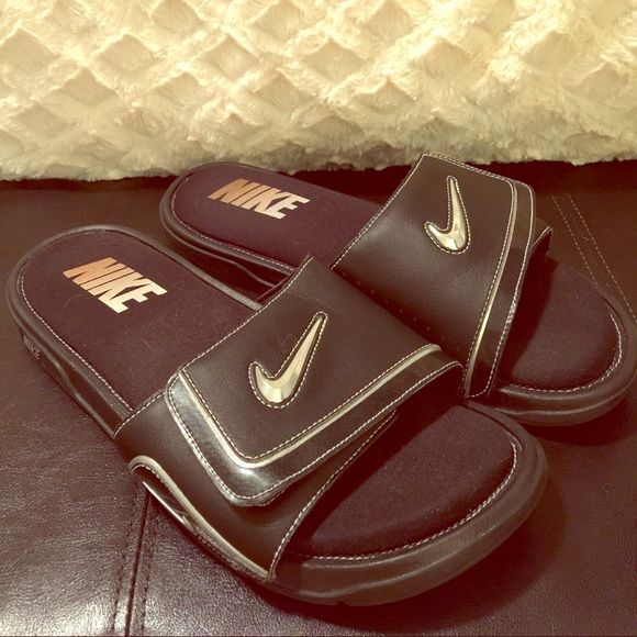 Nike Slip-on Sandals MENS size 12 Comfortable NIKE slip-on sandals. These are a men's size 12. The sole of these sandals feels like a memory foam, they're awesome. Good condition. Nike Shoes Sandals