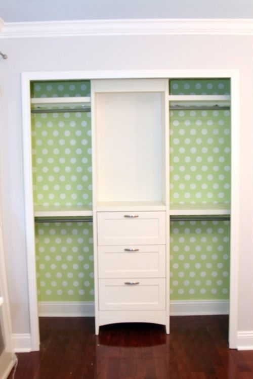 Cute!!  Love the wallpapered closet idea. And curtains in front of the side sections?