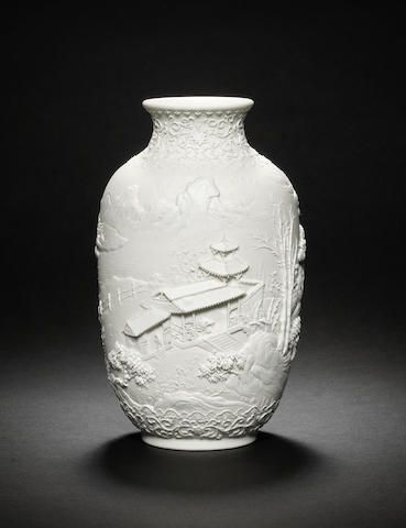 A rare biscuit porcelain relief-carved 'landscape' jar Daoguang seal mark and of the period (2)
