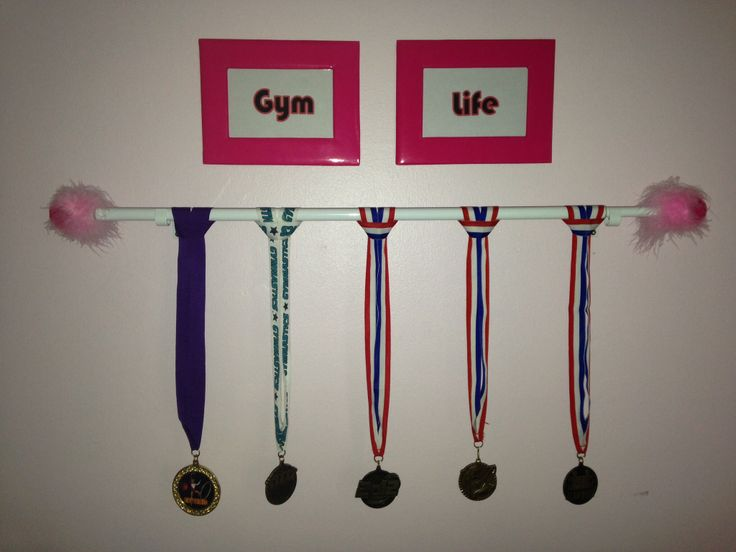Use a curtain rod for an easy and cheap medal/award display