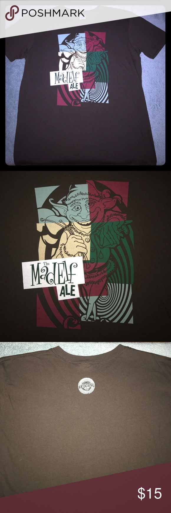 """Troegs Craft Beer """"The Mad Elf"""" Ale Men's T-Shirt For sale is a Size Large, NWOT, Troegs Craft Beer """"The Mad Elf"""" Ale Men's T-Shirt. Shirt is dark brown and features the classic logo of the Seasonal favorite beer, Mad Elf! A must have for the craft beer lover in your family! Gildan Shirts Tees - Short Sleeve"""