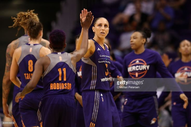 Diana Taurasi #3 of the Phoenix Mercury high fives Danielle Robinson #11 after scoring against the Washington Mystics during the second half of the WNBA game at Talking Stick Resort Arena on July 5, 2017 in Phoenix, Arizona. The Mercury defeated the Mystics 88-80.