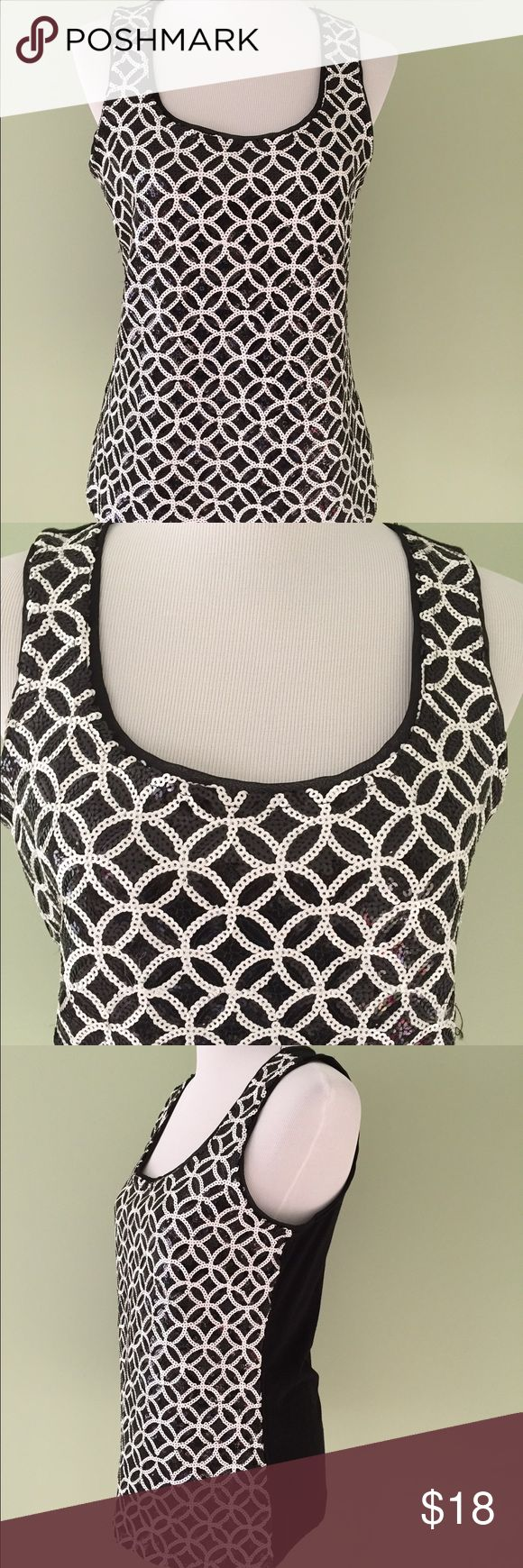 "White House Black Market Sequin Tank Top Medium WHBM White House Black Market Black and White Sequin Tank Top Very pretty and perfect for dressing up for an evening out. Size Medium Armpit to armpit is 17"" Length from shoulder to hem is 24.5"" Excellent condition. No stains or flaws. White House Black Market Tops Tank Tops"