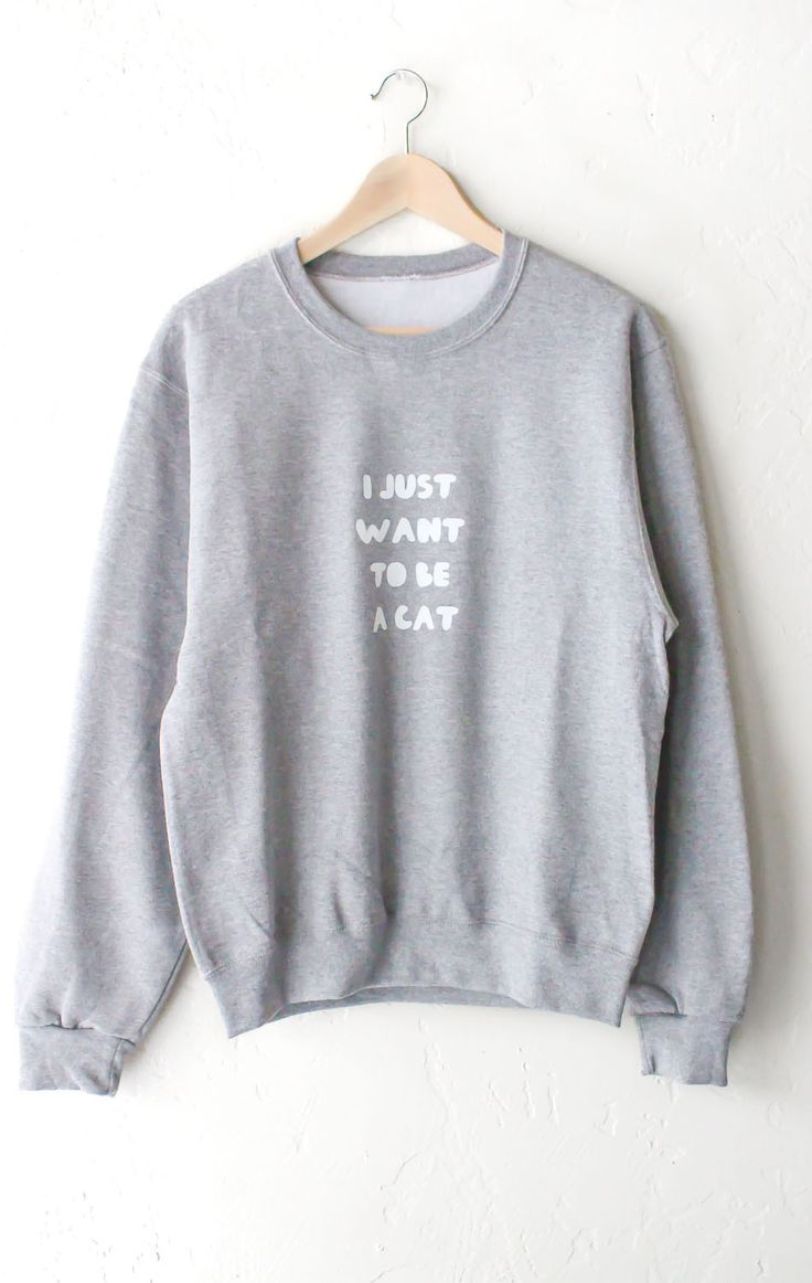 "- Description - Size Guide Details: 'I Just Want To Be A Cat' oversized sweater in light grey. Unisex fit. Brand: NYCT Clothing. 50% Cotton, 50% Polyester. Imported. Sizing: 40"" / 101.6 cm width 25"" /"
