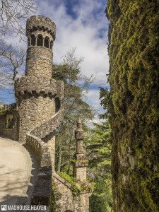 Gothic tower, battlements of Quinta de Regaleira looking over the hillside of Sintra
