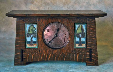 A gorgeous Arts & Crafts Studio clock by Terry Cross featuring Sassafrass Pottery tiles (Sarah Moore) - Craftsman - Courtesy of the Dr. Amelia Woods collection
