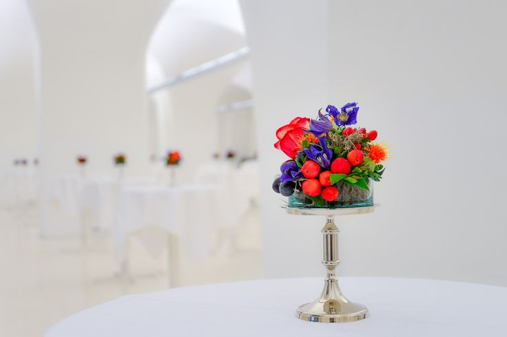 floral standing table decoration in red and violet
