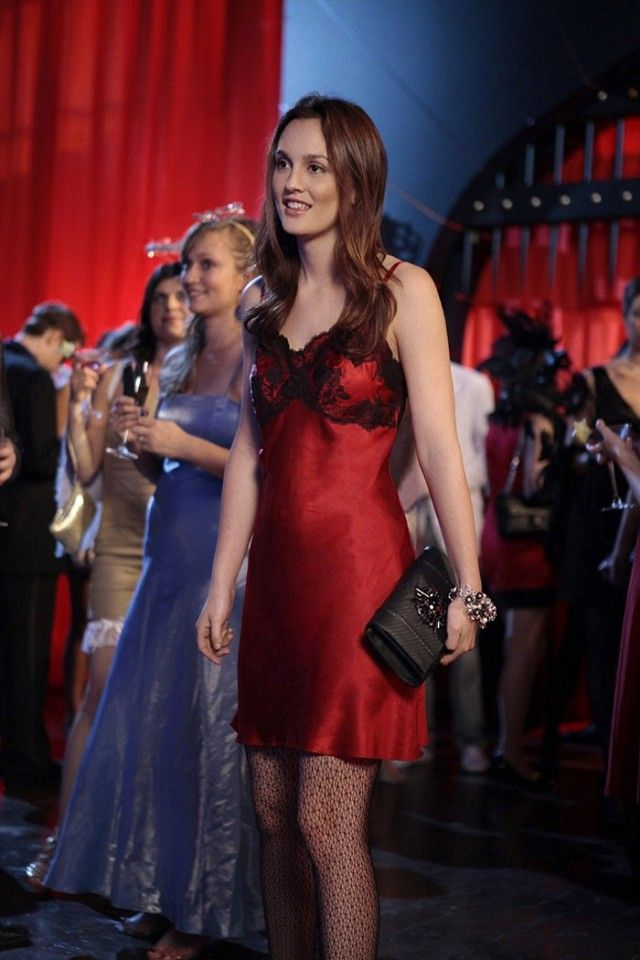 Blair Waldorf wears a red slip dress, fishnet tights, a clutch, and a statement bracelet
