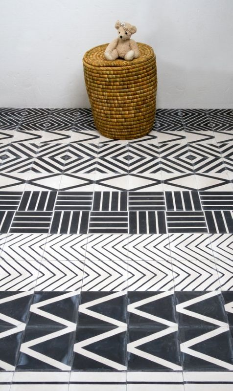 Tribal patterns. Handmade tiles can be colour coordinated and customized re. shape, texture, pattern, etc. by ceramic design studios