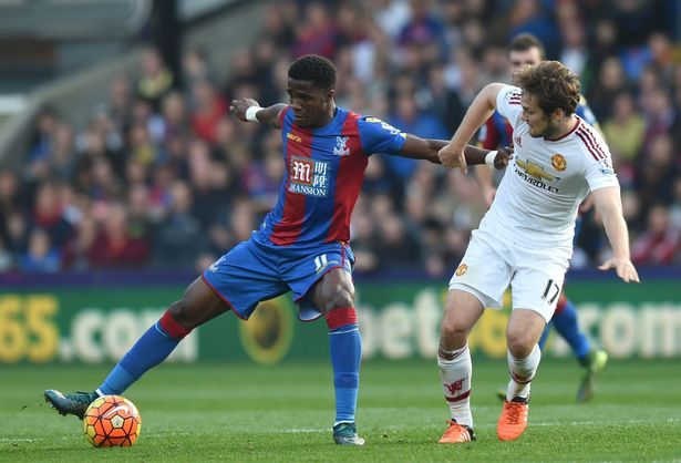 Daley Blind vies with Wilfried Zaha