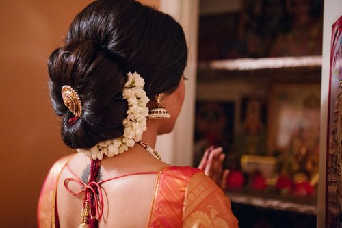 What a beautiful large low bun with gajra & juda pin. Care however should be taken before adopting such hairstyles, as due to it's high static charge, it will cause phlegm to move up in the throat, causing the voice to quaver & a frequent urge to clear the throat. A heavy chabi chhalla with a long & wide hook if inserted at the edge of the pleats of the saree, will reduce this problem as it's hook will activate the acupressure points that act to keep the throat clear.