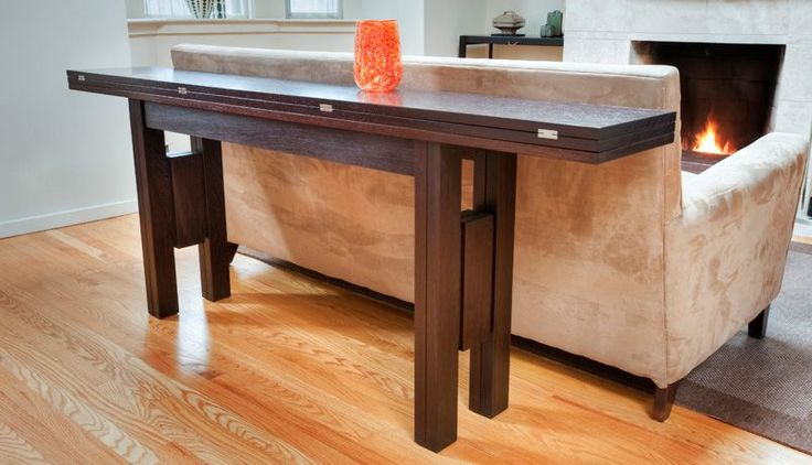"""A modern space-saving table design, the Transformer Table expands laterally from a 12"""" wide console to a 36"""" wide dining table. Ideal for city apartments."""