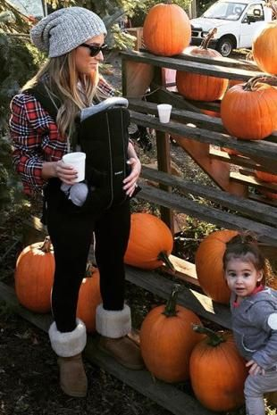 Jessie James Decker wearing Ugg Classic Tall Boots in Chestnut, Love Your Melon Navy Speckled Beanie, Ray-Ban Rb2140 Original Classic Wayfarer Sunglasses and Kittenish Rachel Green Shirt
