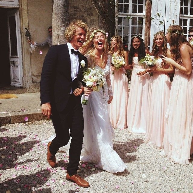 Love the look of this! The bride's dress, the groom's tux, the bridesmaids' dresses & hair & flower crowns... beautiful!