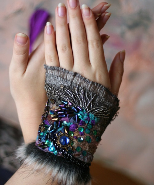 She Wolf, medieval fantasy influenced romantic wrist wrap from antique lace and nuno felt. $68.00, via Etsy.