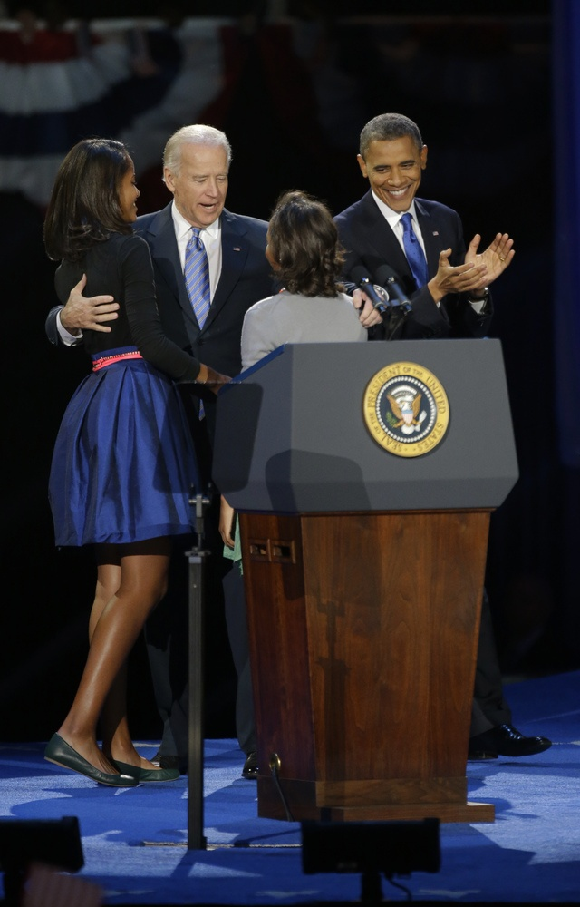 Joe Biden, Barack Obama  Vice President Joe Biden greets President Barack Obama's daughters Malia and Sasha after President's speech at his election night party Wednesday, Nov. 7, 2012, in Chicago. President Obama defeated Republican challenger former Massachusetts Gov. Mitt Romney. (AP Photo/Pablo Martinez Monsivais)