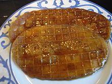 Lackmans, ook wel Laquemant genoemd, is een dunne ovale wafel die over de lengte opengesneden wordt en wordt gevuld met een zeer vloeiende kandijsiroop. Het is een populair kermisgerecht uit de streek rond Antwerpen
