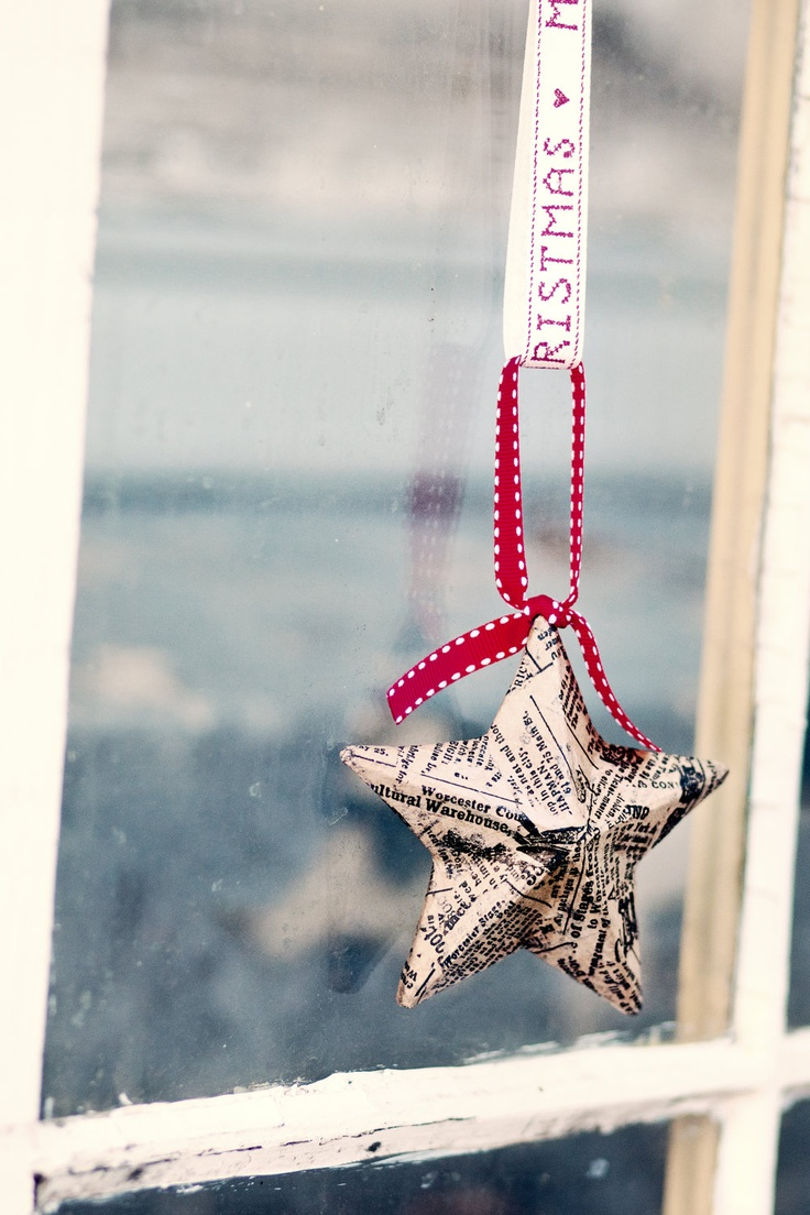 Make origami stars with news paper and modge podge