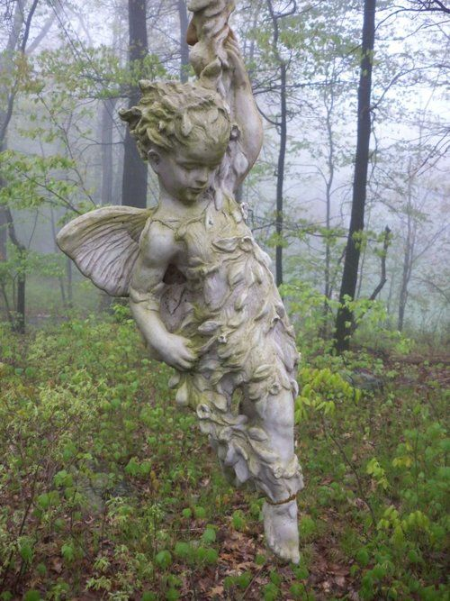 fairy.  Making a fairy garden this year and this would be a cute addition to the garden as u enter.