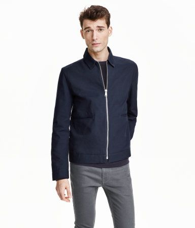 Modern Essentials selected by David Beckham. Jacket in thick cotton canvas with a collar, chunky metal zip at front, and welt front pockets. Unlined.